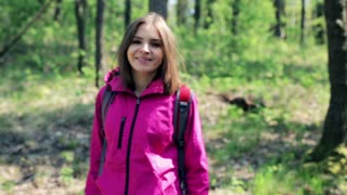 Portrait of young pretty woman in the forest
