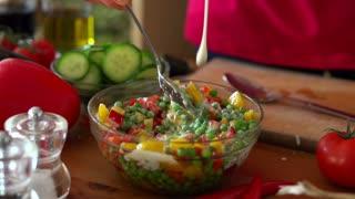 Pouring sauce on vegetable salad, super slow motion, shot at 240fps
