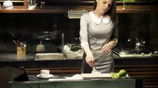 Pretty businesswoman with a cold standing in the kitchen at night HD