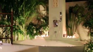 pretty woman preparing bath in the luxury bathroom at night