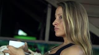 Sad, pensive woman drinking coffee on the terrace