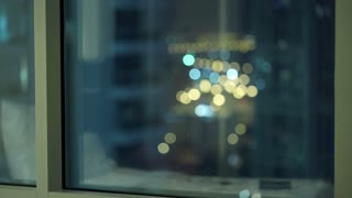 Sad, unhappy man standing by window during night, 4K