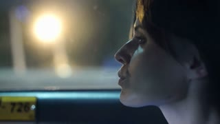 Sad, unhappy woman in car at night, 4K