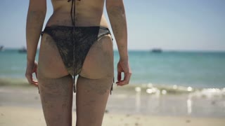 Sexy woman body in bikini standing on the beach,super slow motion, shot at 240fps