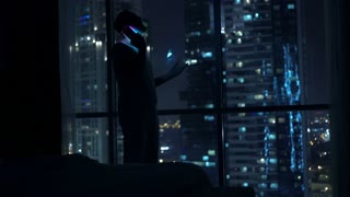 Silhouette of sad, heartbroken man talking on cellphone during night, 4K