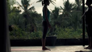 silhouette of young woman learn her friend yoga, dog pose at terrace