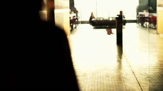 Silhouette of young woman walking through the corridor in the hotel