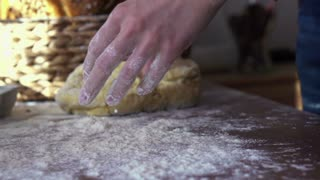 Sprinkling flour on dough, super slow motion, shot at 240fps