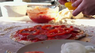 Sprinkling pepper on a homemade pizza, super slow motion, shot at 240fps
