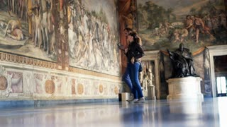 Tourist couple taking photo of fresco paintings at Capitoline Museums