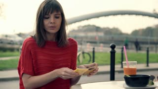Unhappy, impatient woman waiting for someone in street cafe
