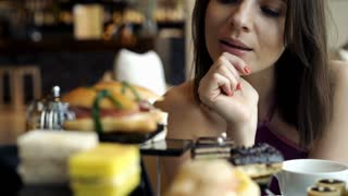 Beautiful woman eating tasty cake at cafe, 4K
