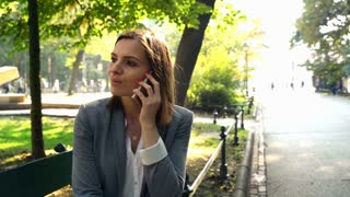Businesswoman talking on cellphone in the city