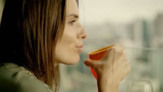 Happy, young woman drinking, 4K