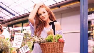 Portrait of beautiful woman with red hair at local farmers market