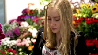 Portrait of happy, cute teenager girl at florist`s