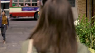 Portrait of happy, young woman walking in city, super slow motion 240fps