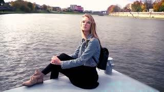 Pretty cute teen girl relaxing close to the river