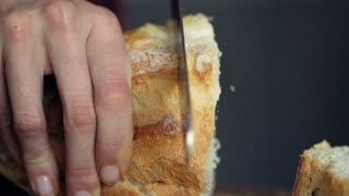 Woman hands slicing bread