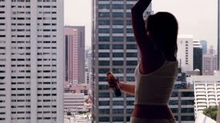 Young, pretty woman applying deodorant on her armpit close to the window, 240fps