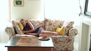 Young, pretty woman sleeping on sofa