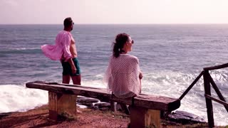 Young, sad couple looking on the sea, 240fps