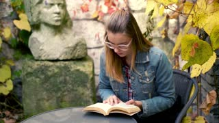 Young woman reading book in the garden