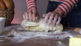 Woman hands kneading dough on the table,