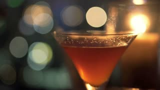 woman hands taking cocktail in cafe at night  HD