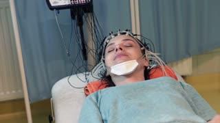 Woman having brain scan in hospital