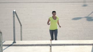 Woman jogging up the stairs in city, super slow motion, shot at 240fps