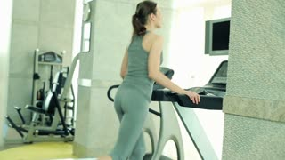woman running on the treadmill in the gym  HD