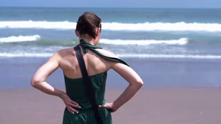 Woman standing on the beach, super slow motion, shot at 240fps