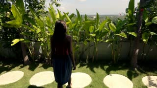 Woman stretching arms and enjoying sunny day on terrace, super slow motion