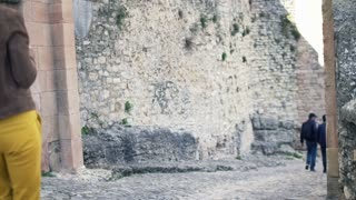 Woman taking photo of ancient wall in Andalusia in Spain