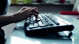 woman`s hands working on keyboard