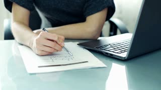 Young beautiful businesswoman hands checking documents with laptop