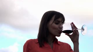 Young beautiful woman drinking wine, 240fps