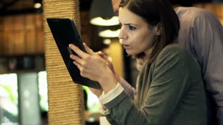 Young business people working with tablet computer and smartphone in cafe HD