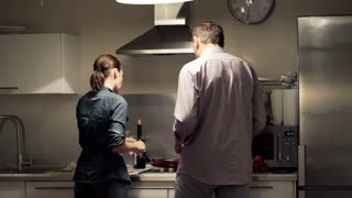 Young couple cooking in the kitchen at home