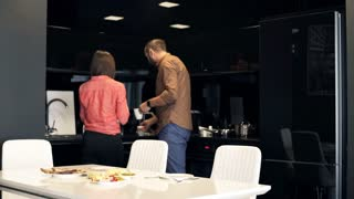 Young couple during breakfast in the kitchen