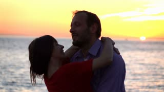 Young couple hugging, turning around on beach, slow motion 240fps