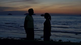 Young couple in love, kissing on beach during sunset,4K