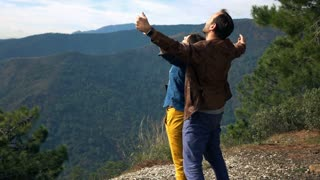 Young, couple standing in titanic pose and enjoying beautiful mountains view, 240fps