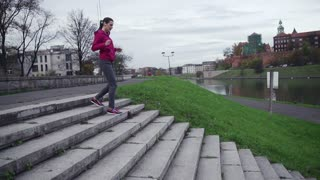 young female jogger running down the stairs super slow motion, shot at 240fps
