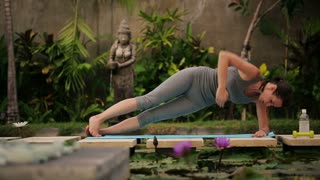 young girl exercising in the exotic garden