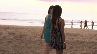 Young girlfriends walking on the beach, super slow motion, shot at 240fps