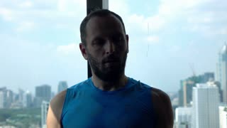 Young handsome man doing exercise with dumbbell on the gym, super slow motion, 120fps