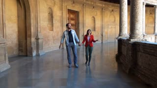 Young, happy couple sightseeing old amphitheatre building, super slow motion