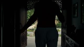 Young, happy man dancing in the door with beautiful garden view, 4K